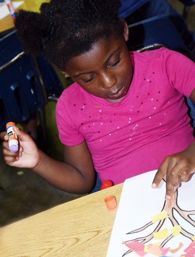 CES kindergartener Harmony Brown makes her fall tree.