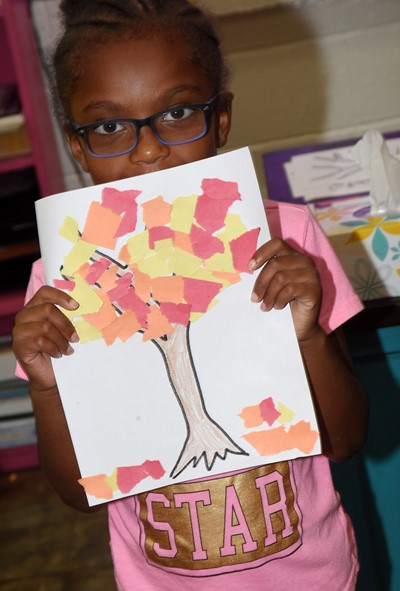 CES kindergartener Daya Griffin holds her fall tree.