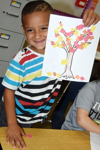 CES kindergartener JayLine Williams holds his fall tree.