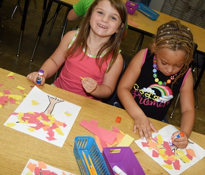 CES kindergarteners Serenity Cox, at left, and Jayla Barbee make their fall trees.