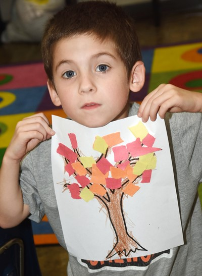 CES kindergartener Charlie Woodbury holds his fall tree.