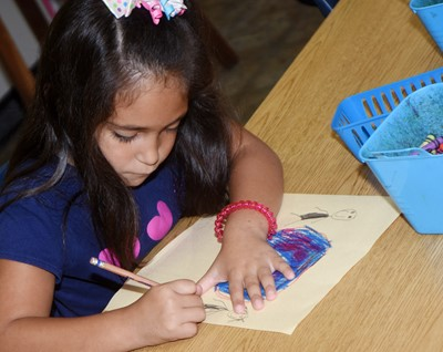 CES kindergartener Shanika Blakeman draws a picture of how she can be kind to others.