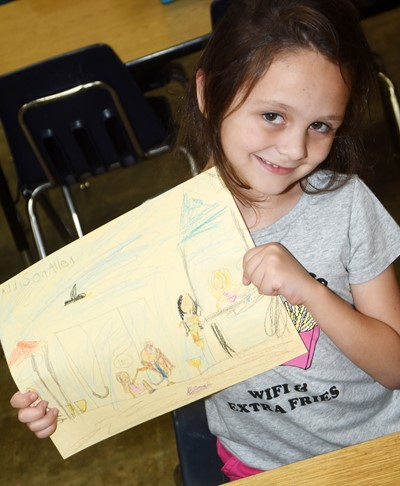 CES kindergartener Addison Allen holds the picture she drew showing how she can be kind to others.