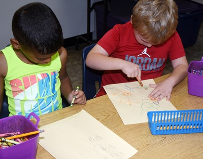 CES kindergarteners Eli Howard, at left, and Tressie Sears draw pictures of how they can be kind to others.