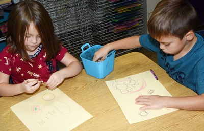 CES kindergarteners Aubrie Smothers, at left, and Ryder Terry draw pictures of how they can be kind to others.