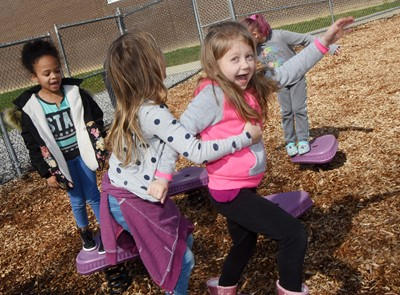 CES first-grader Maci Boyd plays on the playground with her classmates.
