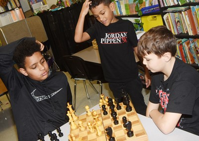 CES fourth-graders Romeo Goins, Derik Bishop and Jaxson Hunt play chess together.