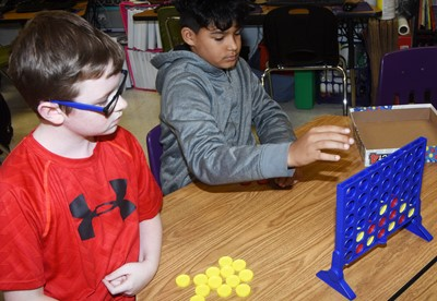 CES fourth-graders Jayden Cox, at left, and Rizzo McKenzie play Connect Four together.