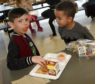 CES first-grader Joseph Segura has some fun at lunch.
