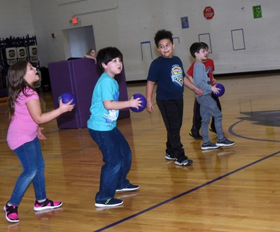 CES second-graders Alaziah Smith, at left, and Victrin Ramsey play dodgeball with their classmates.