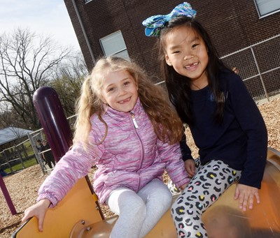 CES first-graders Katie Parrish, at left, and Marla Bat have fun on the playground.