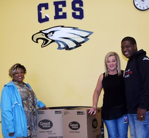 Campbellsville Independent Schools recently received a donation from Greater Campbellsville United that will help keep students well this school year. GCU members, under the direction of Coordinator Wanda Washington, at left, organized a Tissue Drive to collect boxes for local school systems. Washington recently donated the boxes to Campbellsville Elementary School. Pictured with Washington are CES Attendance Clerk Sharon Mills and Washington's son Josh.