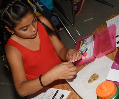 CES second-grader Carmela Hollowell removes the chips from her chocolate chip cookie dough.