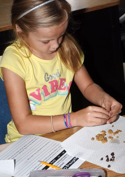CES second-grader Trinidy Gribbins removes the chips from her chocolate chip cookie dough.