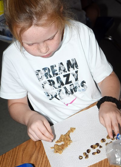 CES second-grader Macilynn Mann removes the chips from her chocolate chip cookie dough.