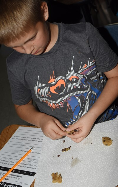 CES second-grader Jacob Parrish removes the chips from his chocolate chip cookie dough.