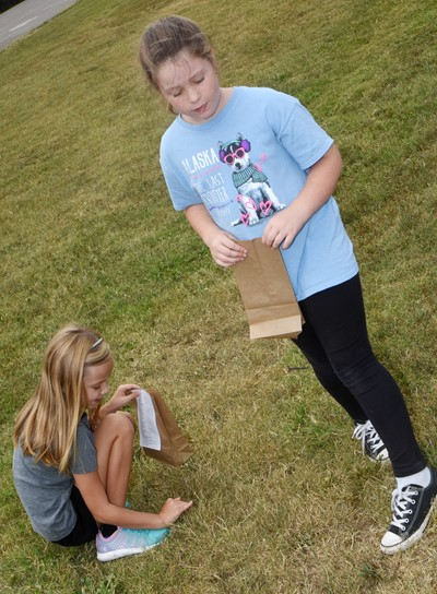 CES second-graders Trinidy Gribbins, at left, and Zoey Benton search for treasures.