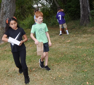 CES second-grader Carmela Hollowell, at left, and Kennon Dotson search for treasures.