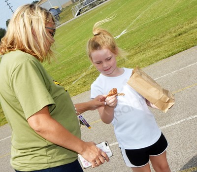 CES second-grader Macilynn Mann shows her teacher Amanda Greer the treasures she found.