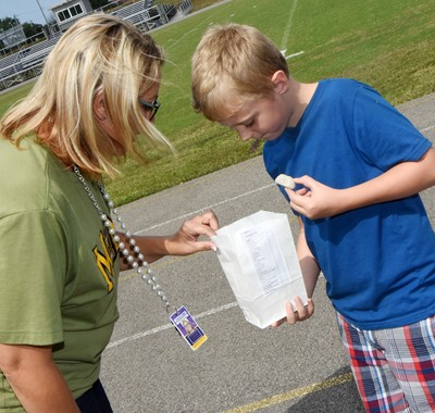 CES second-grader Lukas Adams shows his teacher Amanda Greer the treasures he found.