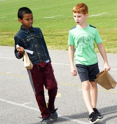 CES second-graders Arpan Shah, at left, and Kennon Dotson search for treasures.