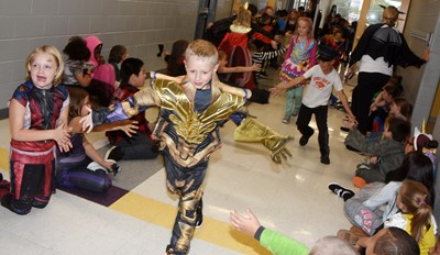 CES students and staff members participate in a Parade of Costumes on Halloween.