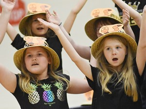 CES second-graders Aubreigh Knifley, at left, and Jewell Brewster sing and dance.