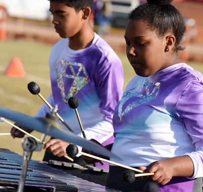 Campbellsville Middle School seventh-grader Gabriel Noyola, at left, and CHS senior Zaria Cowan play percussion.