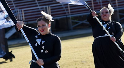 Campbellsville Middle School seventh-grader Kaylyn Lawson, at left, and CHS sophomore Abby Turner perform.