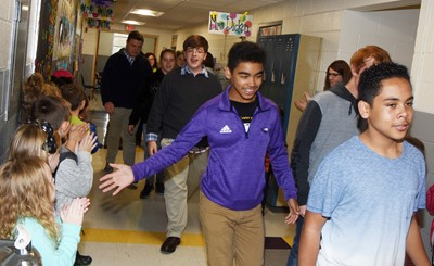 Campbellsville Middle School seventh-grader Gabriel Noyola participates in an Eagle Walk down the CES hallway with his fellow band members.
