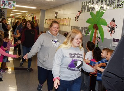 CHS sophomore Abby Turner, at left, and junior Riley Rainwater walk down the CES hallways in an Eagle Walk.