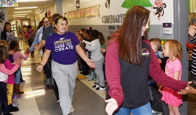 CHS senior Brandy Miller, at left, and junior Mystique Jones high-five CES students as they participate in the Eagle Walk.