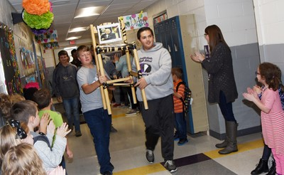 Campbellsville Middle School eighth-grader Zach Akin, at left, and CHS sophomore Kaine Terry participate in an Eagle Walk down the CES hallways.