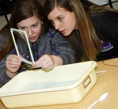 CHS freshmen Alysa Howard, at left, and Mikaela Scharbrough look at their bubble membrane.