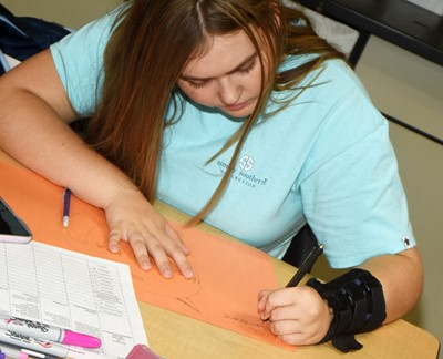 CHS sophomore Isabella Vannice draws a cell diagram.