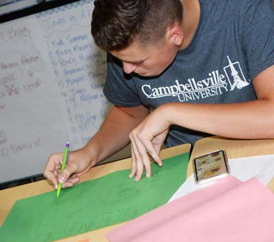CHS senior Gavin Johnson draws a cell diagram.