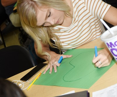 CHS junior Carly Adams draws a cell diagram.