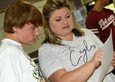 CHS teacher Lauren Bennett helps sophomore Tuff Harper as he analyzes his data.