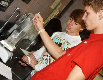 CHS sophomore Tuff Harper, at left, and Damon Johnson record the temperature of their boiling water.