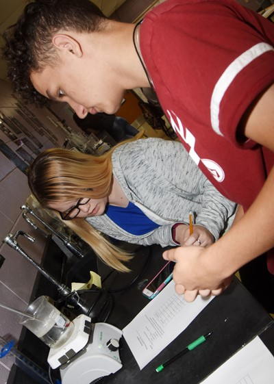 CHS sophomores Xierra Underwood, at left, and Luke VanWinkle record the temperature of their boiling water.