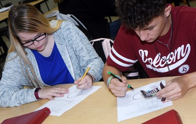 CHS sophomores Xierra Underwood, at left, and Luke VanWinkle graph their data to show the color of their m&m candies.