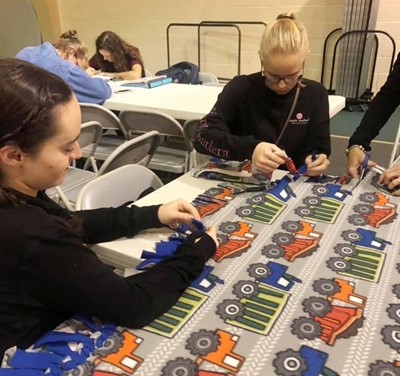 CHS seniors Jewell Cox, at left, and Tahler Franklin make blankets at the Central Kentucky Beta Invitational.