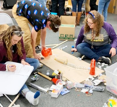 From left, CHS senior Katelyn Miller, sophomore Peyton Dabney and senior Emily Rodgers compete in the engineering competition at the Central Kentucky Beta Invitational.