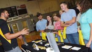 From left, CHS seniors Luke Richards, Alli Wilson, Shelby Smith, Isabella Osborne, Gavin Johnson and Abie Angel get information about Northern Kentucky University.