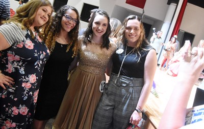 CHS senior Zoe McAninch, third from left, smiles with her friends and classmates, from left, Aleah Knifley, Taliyah Hazelwood and Katelyn Miller.