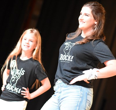 CHS senior Alli Wilson participates in the DYW opening number with her little sister.