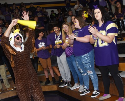 CHS teacher Ben Davis leads students in a cheer.
