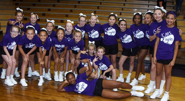 CMS cheerleaders smile before the pep rally.