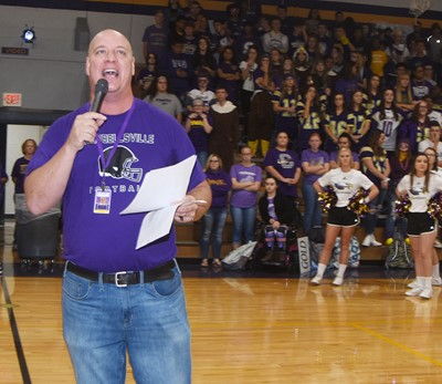 CIS Food Service Director David Petett is the emcee for the pep rally.