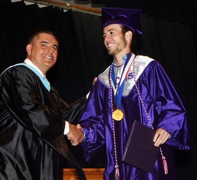 Campbellsville Independent Schools Superintendent Kirby Smith congratulates Layton Hord.